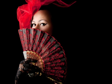 Beautiful elegant woman hiding behind the fan photo