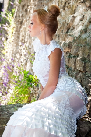 Portrait of beautiful bride in the park photo
