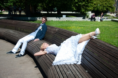 Beautiful wedding couple relaxing in the park photo