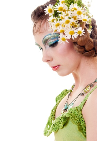 Young woman with fantasy make-up made in blue and green colors