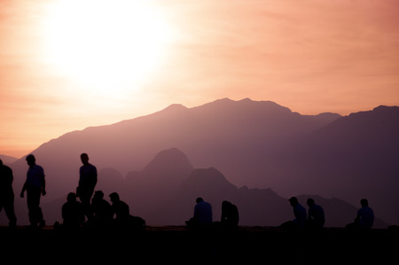 moutains: Silhouttes of people enjoying sunset, moutains background in Antalya, Turkey Stock Photo