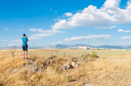 beginner: Young man is taking a photo of picturesque place in Sandikli, Turkey Stock Photo