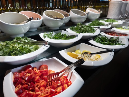 Great selection of varied fresh salads on the row in all inclusive 5 star hotel, dinner time. Stock Photo