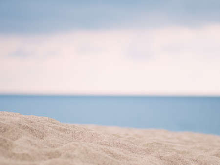 Closeup of white sand with blue sea background 写真素材