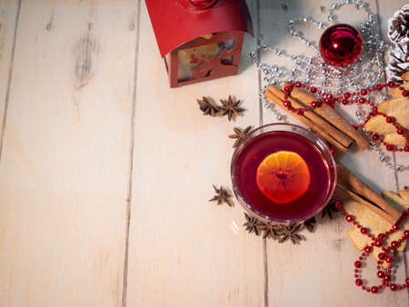 Mulled wine, cinnamon ginger cookies and Christmas decorations on the table 写真素材