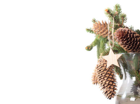 A bouquet of fir branches with cones and star decoration isolated on white background. Christmas and New Year gifts. Copy space