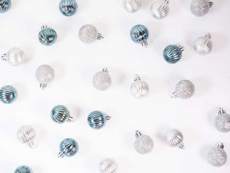Christmas background. Glitter blue and silver Christmas balls pattern. Flat lay, top view.