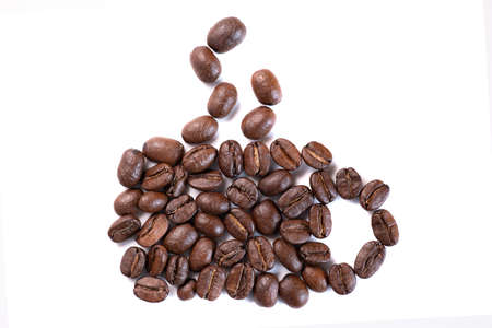Closeup high angle view of coffee beans in cup with steam shape on white background 写真素材