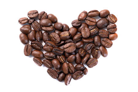 Closeup high angle view of coffee beans in heart shape isolated on white background 写真素材