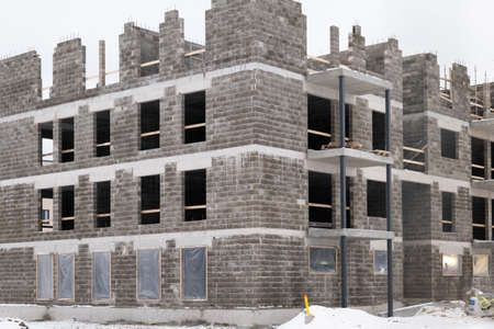 Modern european concrete block apartment building construction in winter time