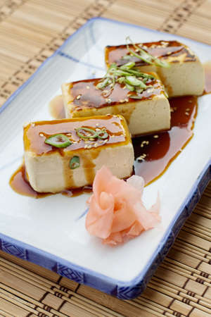 Grilled Tofu (Soybean Curd) with soy sauce and pickled ginger
