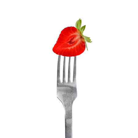 Slice of Strawberry on Fork isolated on white background - studio shot