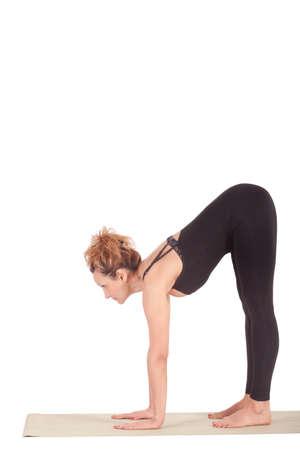 Beautiful Yoga: Hand to Big Toe Pose - Real senior woman doing Padangushtasana 版權商用圖片