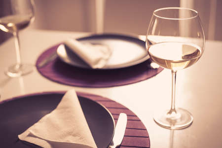 Romantic memories - Table setting for Two - Wine glasses with white wine