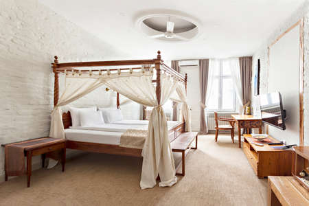 Hotel room - vacation concept background - Luxurious modern bedroom interior with canopy bed Archivio Fotografico