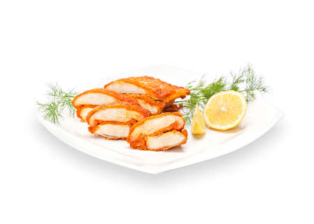 Hot Fried Crispy Chicken boneless drumstick in batter on a white plate with lemon slices and dill.