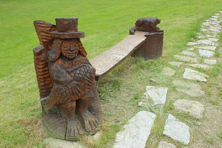 wooden carved waterman servingas a bench