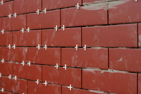 clinker tile: Clinker tiles arranging to wall with pegs.