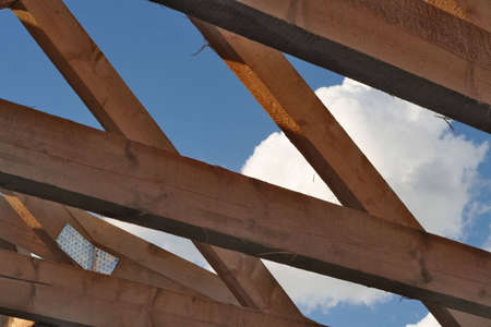 superstructure: Girders in a house under the blue sky.