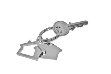 A key with a blank tag isolated on white photo