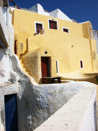 White and colourfull houses in a small village Santorini