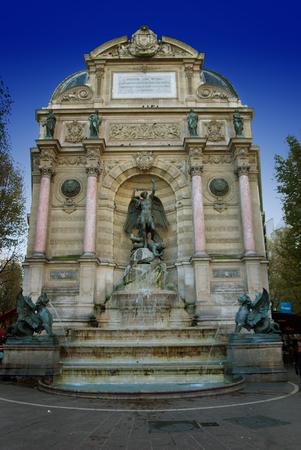 Saint Michael fountain in Paris,France - in summer time photo