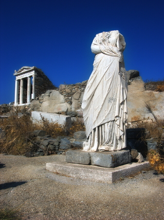 Stone headless statue of women in island Delos near the Mykonos,Greece photo