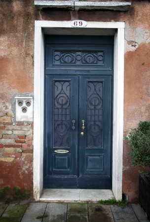 Traditional wooden old fashioned door in Venice,Italy photo
