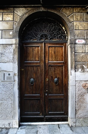 Traditional wooden old fashioned door in Venice,Italy
