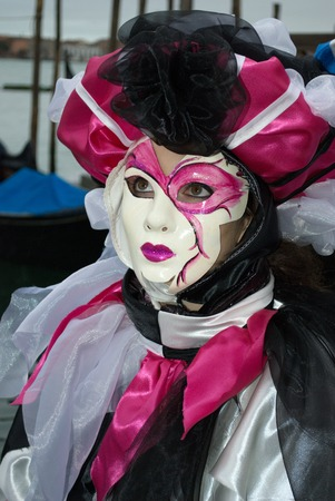 Carnival in Venice and masquarade performance by the sea