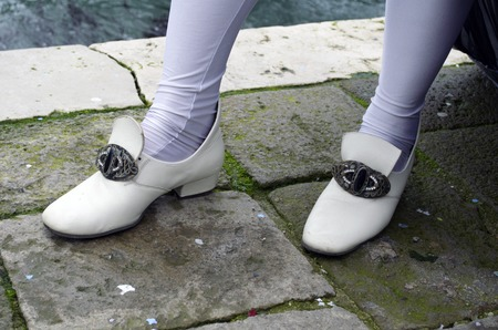 motionless: Shoes and socks at the venetian carnival in Venice Stock Photo
