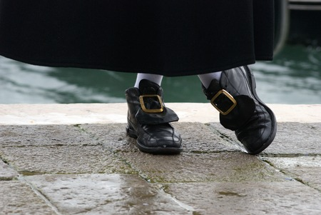 Shoes and socks at the venetian carnival in Venice Stock Photo