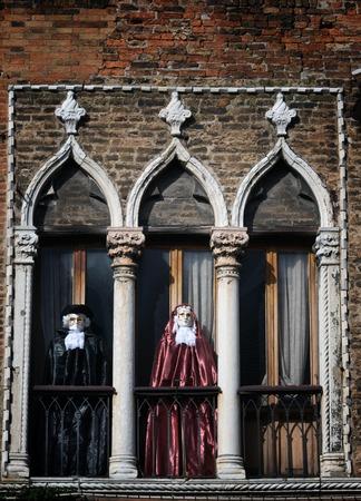 Venetian costumes decoration in the balcony in Murano island in Venice