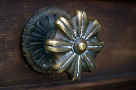 Venetian Gilded Doorhandle in Murano, Venice island photo