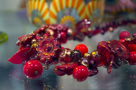 Red color murano glass necklace in shop window in Venice photo