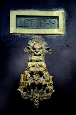 Maltese door knob on dark wooden door in Valleta,Malta