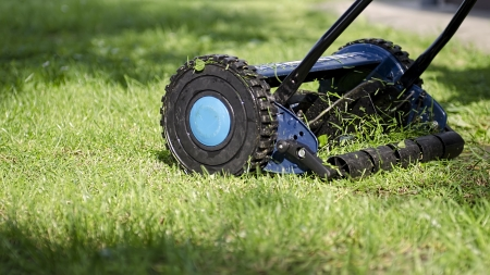 Lawnmower in action Stock Photo - 13910034