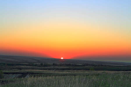 colorful sundown sun in steppe by springtime Stock Photo - 13547653