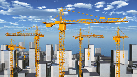 building site: Construction cranes in a city landscape