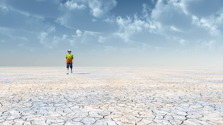 dryness: Man walking in the desert