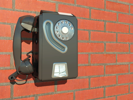 obsolete: Wall phone on a house wall Stock Photo