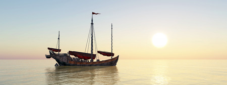 Chinese junk ship at anchor at sunset Stock Photo