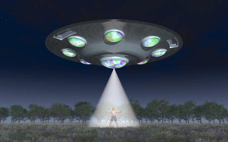 platillo volador: Man in the light beam of a flying saucer Foto de archivo