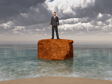 steady: Businessman on a rock in the surf