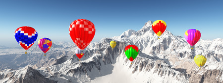 Hot air balloons over snow covered mountains