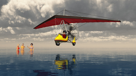 Ultralight trike over the sea and bathing women Stock fotó