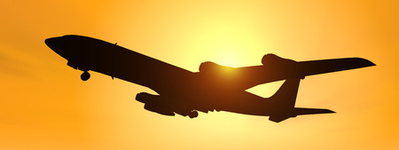 Silhouette of an airliner against a yellow sky