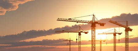 Construction cranes at sunset Reklamní fotografie