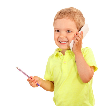 hp: young boy talking on the smartphone and holding a pen Stock Photo