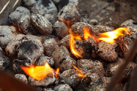 briquettes: Charcoal briquettes ready for barbecue grill. Stock Photo